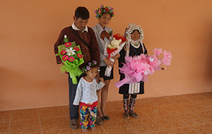 Photo of graduating student with her parents and a younger sibling