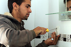 Ayoub, a former school dropout, completed the program and is now working as an electrician